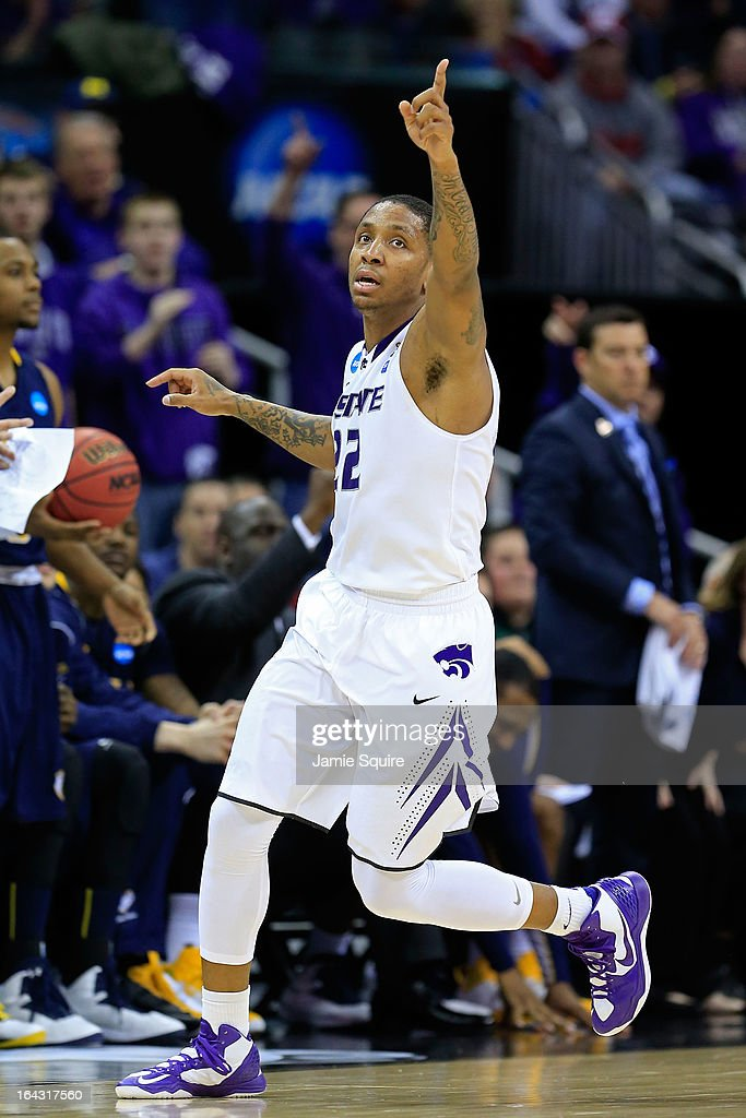 <a gi-track='captionPersonalityLinkClicked' href=/galleries/search?phrase=Rodney+McGruder&family=editorial&specificpeople=6572093 ng-click='$event.stopPropagation()'>Rodney McGruder</a> #22 of the Kansas State Wildcats reacts against the La Salle Explorers in the second half during the second round of the 2013 NCAA Men's Basketball Tournament at the Sprint Center on March 22, 2013 in Kansas City, Missouri.