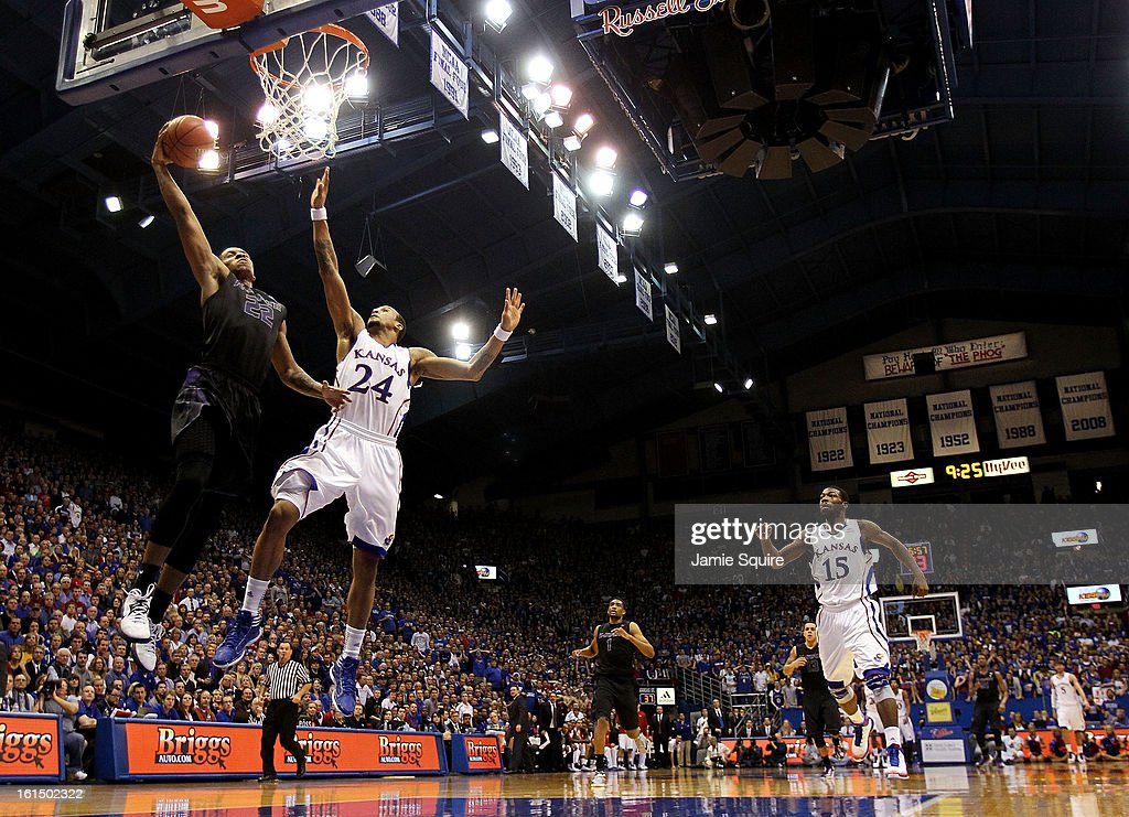 Rodney McGruder #22 of the Kansas State Wildcats scores on a fast break as <a gi-track='captionPersonalityLinkClicked' href=/galleries/search?phrase=Travis+Releford&family=editorial&specificpeople=5628041 ng-click='$event.stopPropagation()'>Travis Releford</a> #24 of the Kansas Jayhawks defends during the game at Allen Fieldhouse on February 11, 2013 in Lawrence, Kansas.