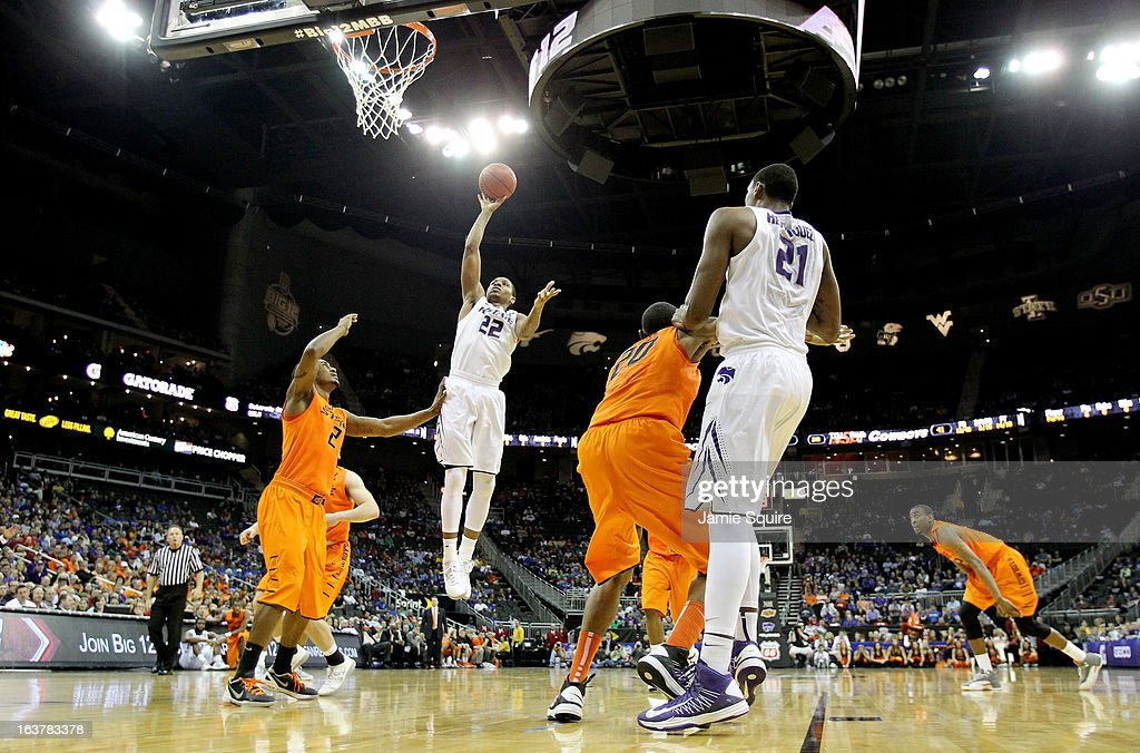 Rodney McGruder #22 of the Kansas State Wildcats shoots against Le'Bryan Nash #2 of the Oklahoma State Cowboys in the second half during the Semifinals of the Big 12 basketball tournament at the Sprint Center on March 15, 2013 in Kansas City, Missouri.