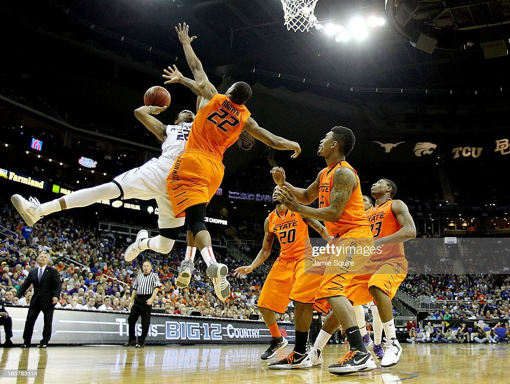 Rodney McGruder #22 of the Kansas State Wildcats shoots against Markel Brown #22 and Le'Bryan Nash #2 of the Oklahoma State Cowboys in the second half during the Semifinals of the Big 12 basketball tournament at the Sprint Center on March 15, 2013 in Kansas City, Missouri.