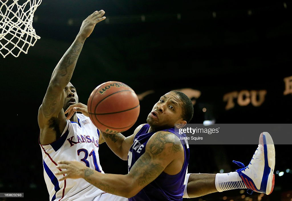 Rodney McGruder #22 of the Kansas State Wildcats watches a loose ball against Jamari Traylor #31 of the Kansas Jayhawks in the first half during the Final of the Big 12 basketball tournament at Sprint Center on March 16, 2013 in Kansas City, Missouri.