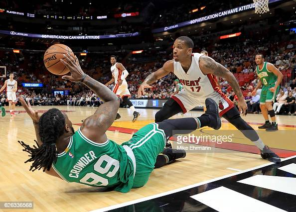 Rodney McGruder of the Miami Heat and Jae Crowder of the Boston Celtics fight for a loose ball during a game at American Airlines Arena on November...