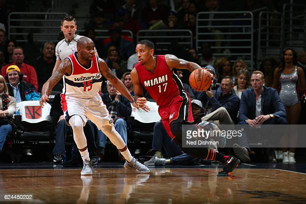 Rodney McGruder of the Miami Heat drives to the basket against Marcus Thornton of the Washington Wizards during a game on November 19 2016 at the...