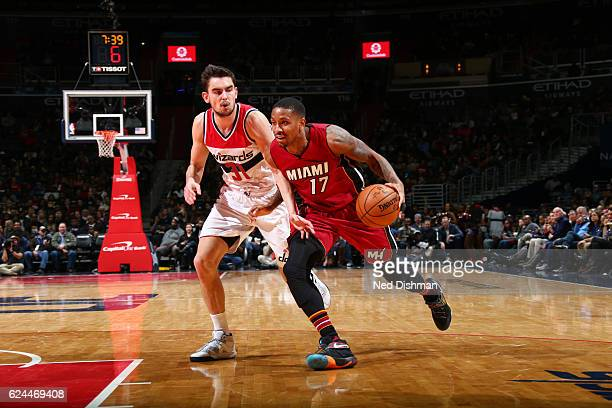 Rodney McGruder of the Miami Heat drives to the basket against Tomas Satoransky of the Washington Wizards during a game on November 19 2016 at the...