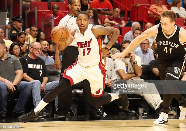 Rodney McGruder of the Miami Heat handles the ball during a preseason game against the Brooklyn Nets on October 11 2016 at American Airlines Arena in...
