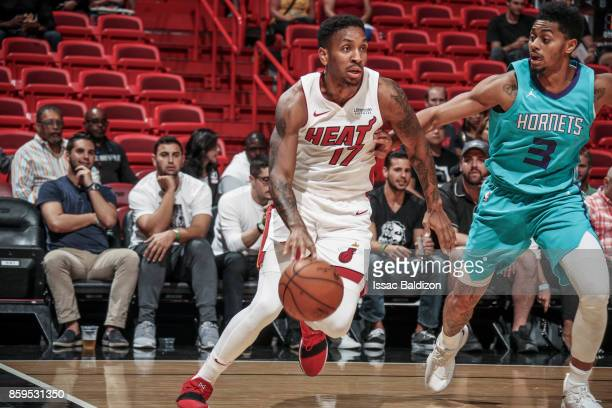 Rodney McGruder of the Miami Heat handles the ball during the preseason game against the Charlotte Hornets on October 9 2017 at AmericanAirlines...