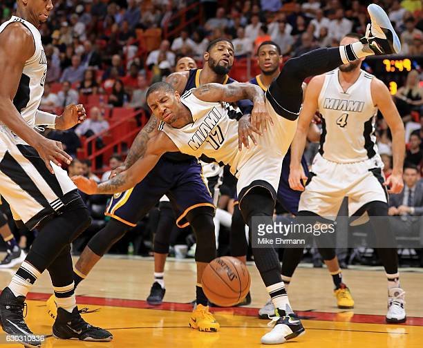 Rodney McGruder of the Miami Heat is fouled during a game against the Indiana Pacers at American Airlines Arena on December 14 2016 in Miami Florida...