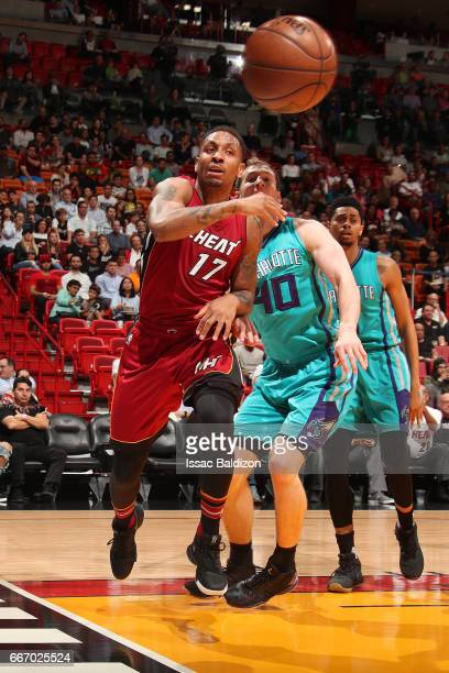 Rodney McGruder of the Miami Heat passes the ball during the game against the Charlotte Hornets on March 8 2017 at AmericanAirlines Arena in Miami...