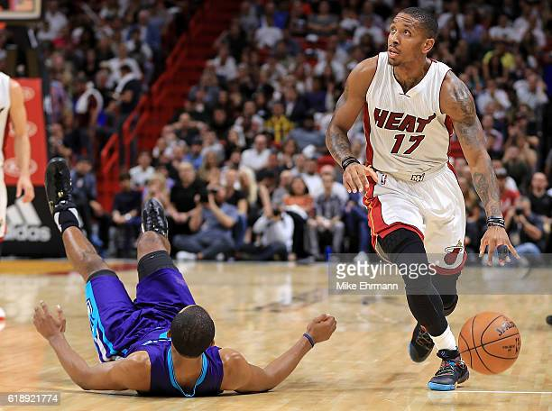 Rodney McGruder of the Miami Heat picks up a loose ball during a game against the Charlotte Hornets at American Airlines Arena on October 28 2016 in...
