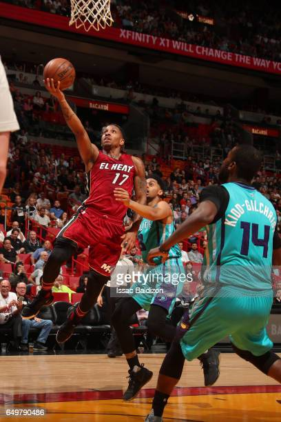 Rodney McGruder of the Miami Heat shoots the ball against the Charlotte Hornets on March 8 2017 at AmericanAirlines Arena in Miami Florida NOTE TO...