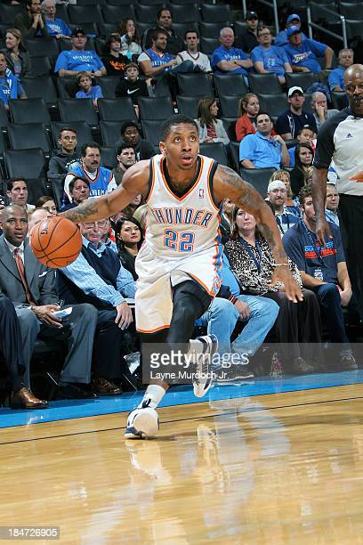 Rodney McGruder of the Oklahoma City Thunder drives to the basket against the Denver Nuggets during a preseason game on October 15 2013 at the...