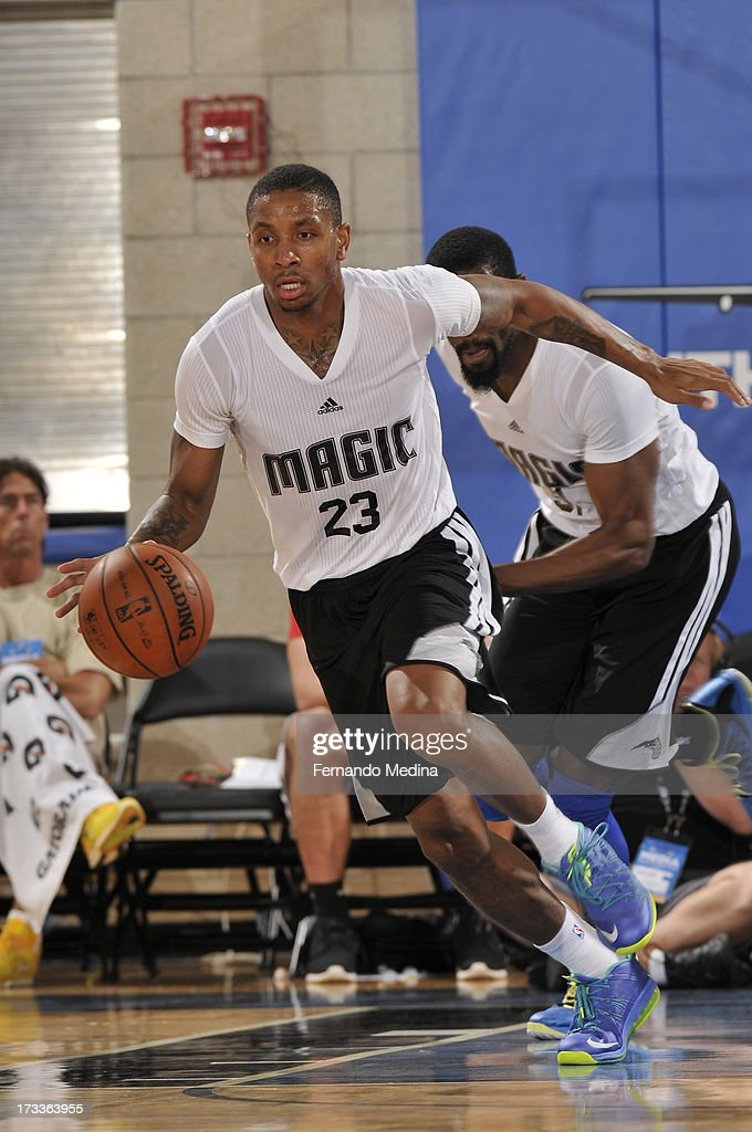 <a gi-track='captionPersonalityLinkClicked' href=/galleries/search?phrase=Rodney+McGruder&family=editorial&specificpeople=6572093 ng-click='$event.stopPropagation()'>Rodney McGruder</a> #23 of the Orlando Magic drives up-court against the Boston Celtics during the 2013 Southwest Airlines Orlando Pro Summer League on July 12, 2013 at Amway Center in Orlando, Florida.