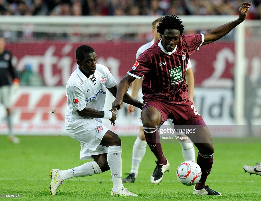 Rodney of Kaiserslautern battles for the ball with Charles Takyi of StPauli during the Bundesliga match between 1FC Kaiserslautern and FC StPauli at...