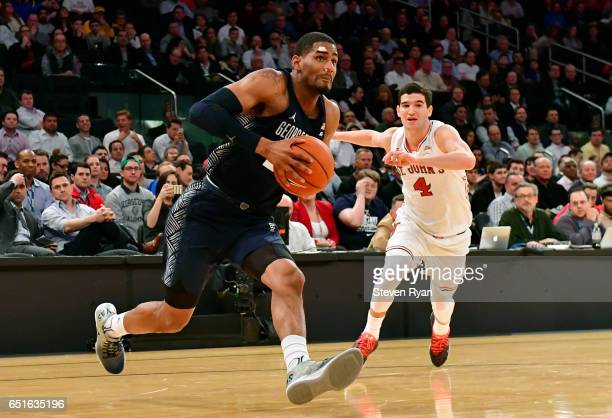 Rodney Pryor of the Georgetown Hoyas is pursued by Federico Mussini of the St John's Red Storm during the first round of the Big East Tournament at...