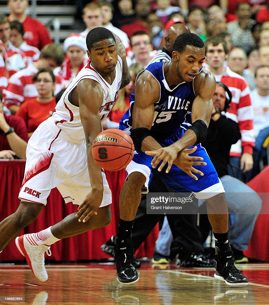 Rodney Purvis #0 of the North Carolina State Wolfpack battles for a loose ball with Jeremy Atkinson #15 of the North Carolina-Asheville Bulldogs during play at PNC Arena on November 23, 2012 in Raleigh, North Carolina. North Carolina State won 82-80.