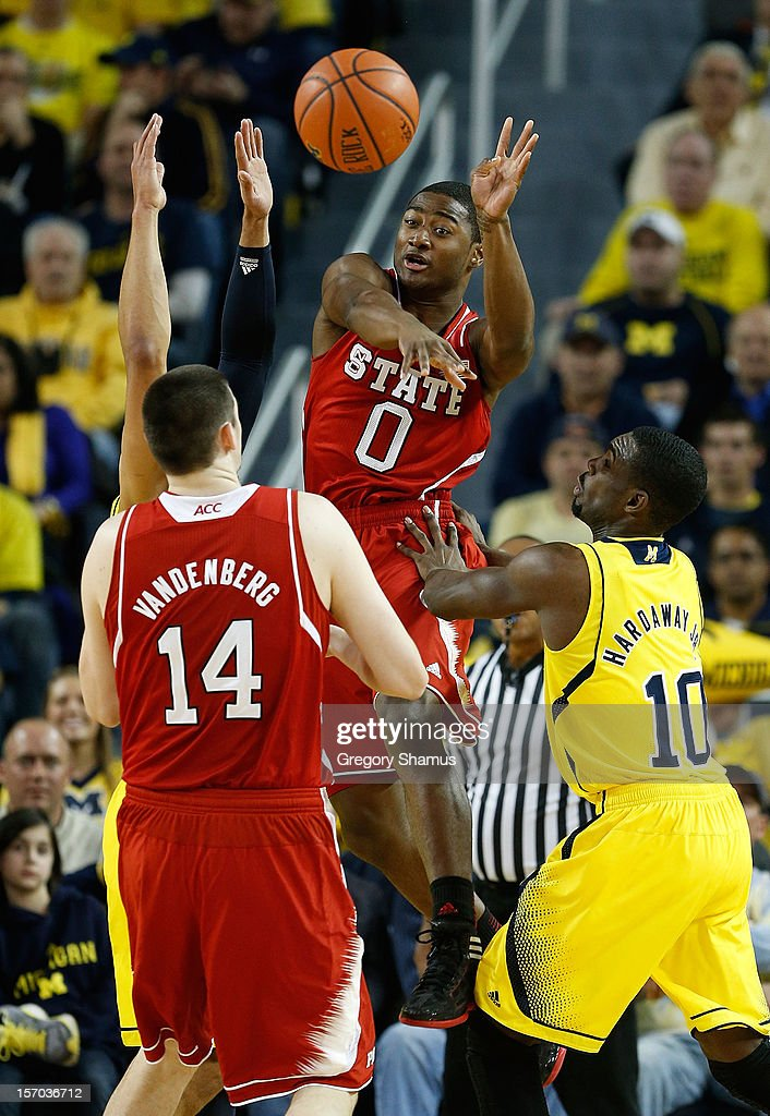 Rodney Purvis #0 of the North Carolina State Wolfpack tries to get a first half pass to Jordan Vandenberg #14 around Tim Hardaway Jr. #10 of the Michigan Wolverines at Crisler Center on November 27, 2012 in Ann Arbor, Michigan. Michigan won the game 79-72.