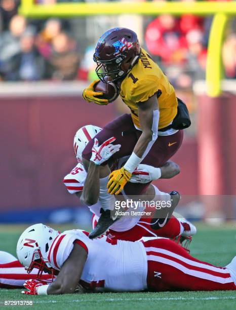 Rodney Smith of the Minnesota Golden Gophers carries the ball for a first down in the first quarter against the Nebraska Cornhuskers at TCF Bank...