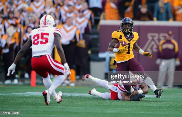 Rodney Smith of the Minnesota Golden Gophers carries the ball for a 27 yard gain and first down in the second quarter against the Nebraska...