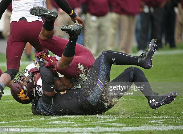 Rodney Smith of the Minnesota Golden Gophers is tackled by Drew Smith of the Northwestern Wildcats at Ryan Field on October 3 2015 in Evanston...