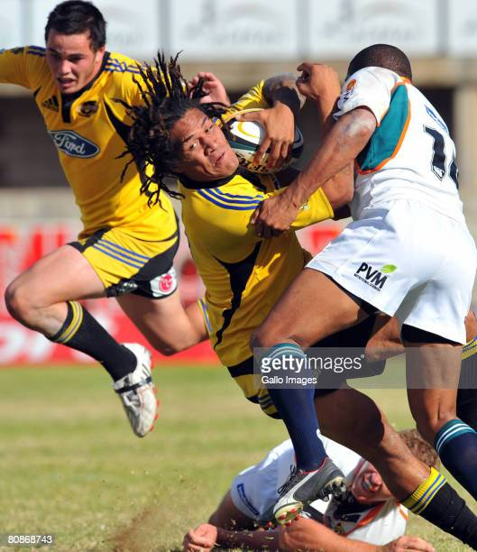 Rodney So'oialo of Hurricanes is tackled by Eddie Fredericks of Cheetahs during the round 11 Super 14 match between the Cheetahs and Hurricanes at...