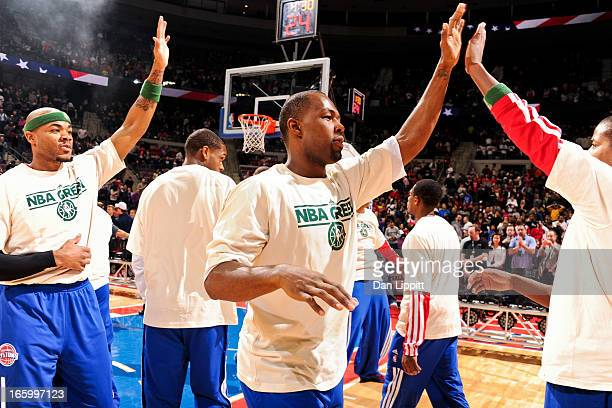 Rodney Stuckey and Corey Maggette of the Detroit Pistons wearing NBA Green Week Tshirts greet teammates before playing against the Chicago Bulls on...