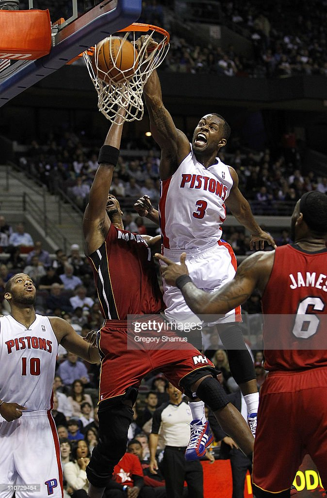 Rodney Stuckey #3 Detroit Pistons gets in for a dunk between Chris Bosh #1 and LeBron James #6 of the Miami Heat at The Palace of Auburn Hills on March 23, 2011 in Auburn Hills, Michigan. Miami won the game 100-94.