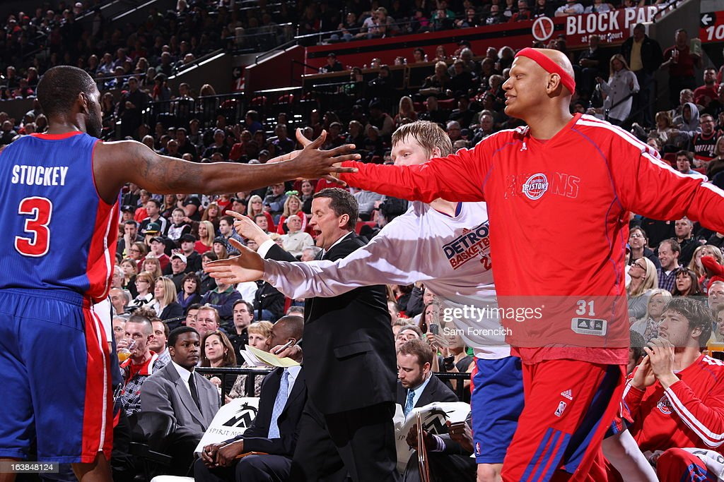 Rodney Stuckey #3 of the Detroit Pistons and Charlie Villanueva #31 of the Detroit Pistons congratulate each other during the game between the Detroit Pistons and the Portland Trail Blazers on March 16, 2013 at the Rose Garden Arena in Portland, Oregon.