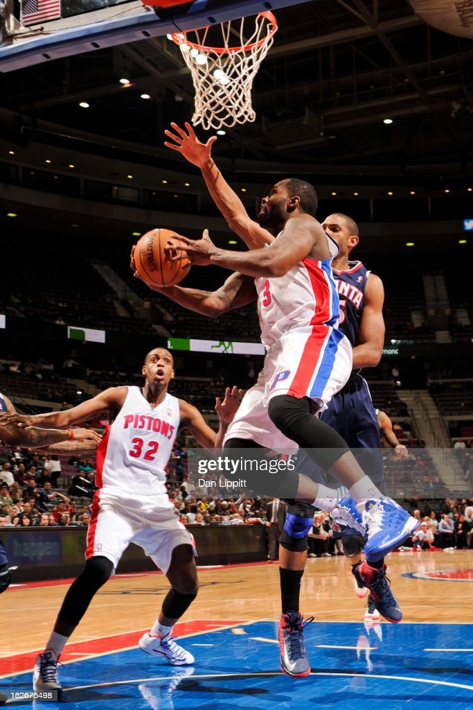 Rodney Stuckey #3 of the Detroit Pistons attempts a reverse layup against Al Horford #15 of the Atlanta Hawks on February 25, 2013 at The Palace of Auburn Hills in Auburn Hills, Michigan.