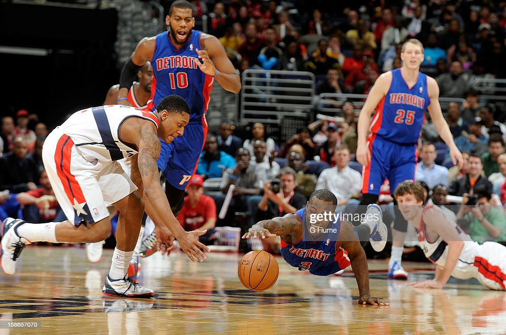 <a gi-track='captionPersonalityLinkClicked' href=/galleries/search?phrase=Rodney+Stuckey&family=editorial&specificpeople=4375687 ng-click='$event.stopPropagation()'>Rodney Stuckey</a> #3 of the Detroit Pistons dives for the ball against <a gi-track='captionPersonalityLinkClicked' href=/galleries/search?phrase=Bradley+Beal&family=editorial&specificpeople=7640439 ng-click='$event.stopPropagation()'>Bradley Beal</a> #3 of the Washington Wizards at the Verizon Center on December 22, 2012 in Washington, DC.
