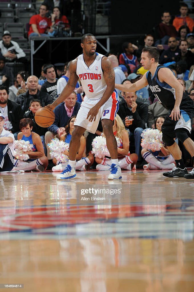 Rodney Stuckey #3 of the Detroit Pistons dribbles the ball against J.J. Barea #11 of the Minnesota Timberwolves during the game on March 26, 2013 at The Palace of Auburn Hills in Auburn Hills, Michigan.