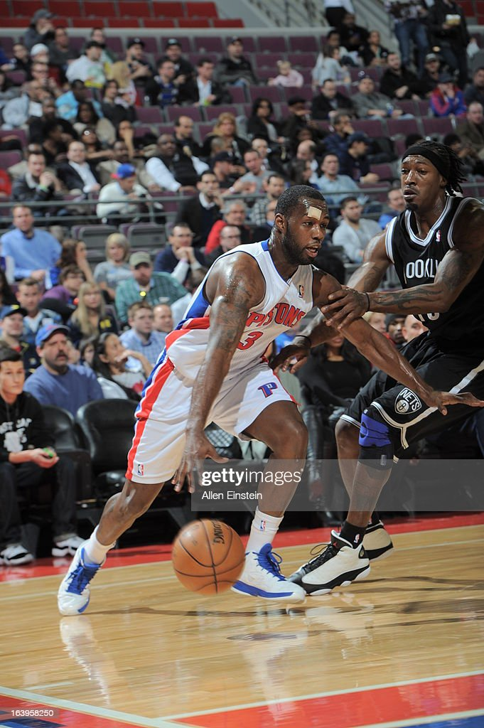 Rodney Stuckey #3 of the Detroit Pistons drives against Gerald Wallace #45 of the Brooklyn Nets on March 18, 2013 at The Palace of Auburn Hills in Auburn Hills, Michigan.