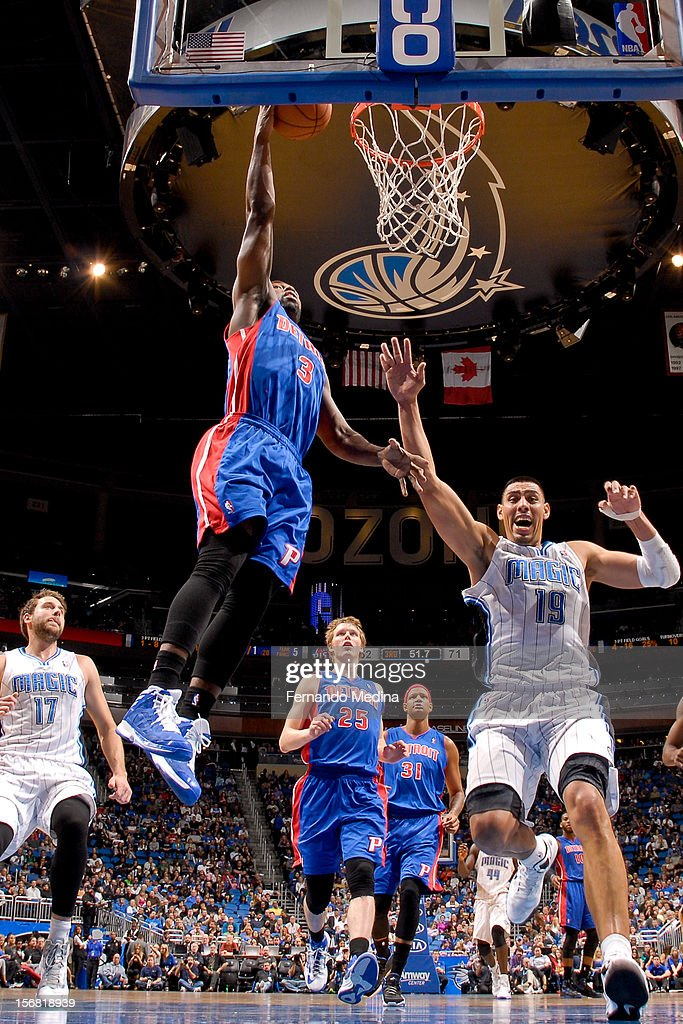 Rodney Stuckey #3 of the Detroit Pistons dunks against Gustavo Ayon #19 of the Orlando Magic on November 21, 2012 at Amway Center in Orlando, Florida.