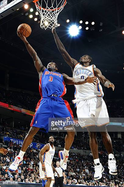Rodney Stuckey of the Detroit Pistons goes to the basket against Serge Ibaka of the Oklahoma City Thunder at the Ford Center on December 18 2009 in...