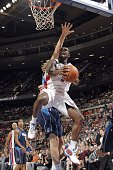 Rodney Stuckey of the Detroit Pistons goes up for a shot against Dirk Nowitzki of the Dallas Mavericks during the game at the Palace of Auburn Hills...