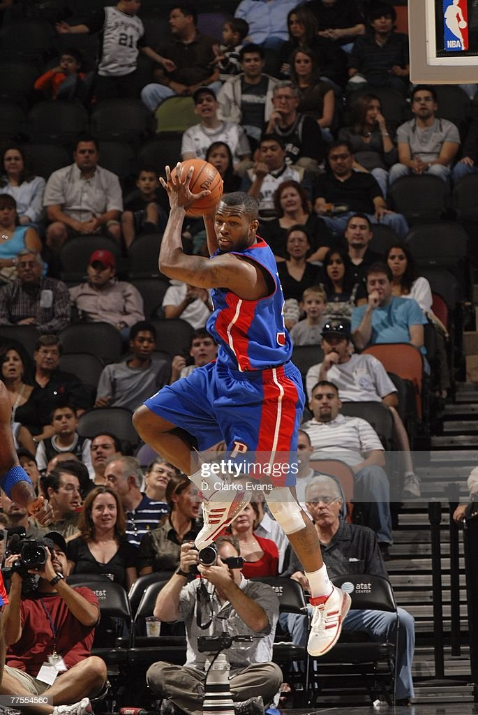 Rodney Stuckey #3 of the Detroit Pistons grabs a rebound as he looks up court to move the ball during a preseason game against the San Antonio Spurs at AT&T Center on October 20, 2007 in San Antonio, Texas. The Spurs won 104-80.