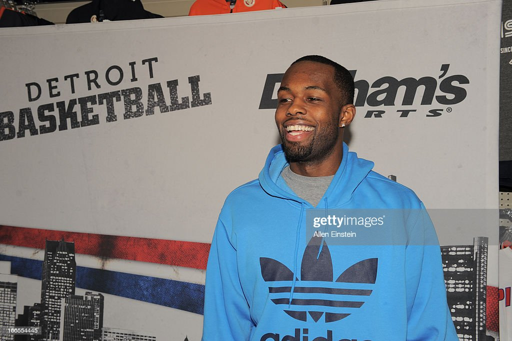 Rodney Stuckey, of the Detroit Pistons, shares a smile with Piston fans during his appearance on April 13, 2013 at Dunhams sporting goods in Warren, Michigan.