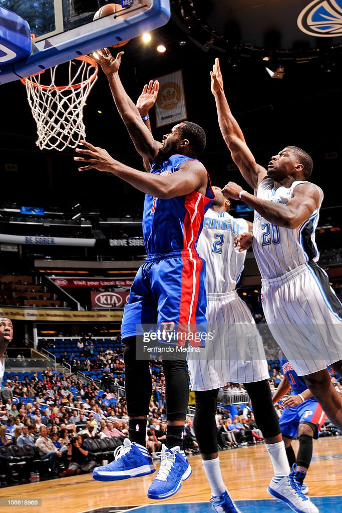 Rodney Stuckey #3 of the Detroit Pistons shoots a layup against Kyle O'Quinn #2 and DeQuan Jones #20 of the Orlando Magic on November 21, 2012 at Amway Center in Orlando, Florida.