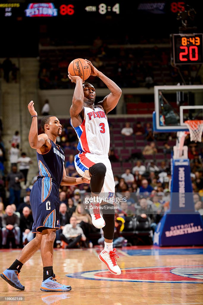 Rodney Stuckey #3 of the Detroit Pistons shoots a three-pointer against Ramon Sessions #7 of the Charlotte Bobcats on January 6, 2013 at The Palace of Auburn Hills in Auburn Hills, Michigan.