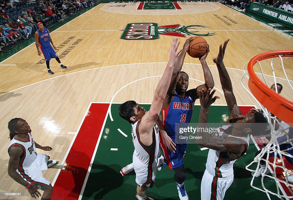 <a gi-track='captionPersonalityLinkClicked' href=/galleries/search?phrase=Rodney+Stuckey&family=editorial&specificpeople=4375687 ng-click='$event.stopPropagation()'>Rodney Stuckey</a> #3 of the Detroit Pistons shoots against (L-R) <a gi-track='captionPersonalityLinkClicked' href=/galleries/search?phrase=Ersan+Ilyasova&family=editorial&specificpeople=557070 ng-click='$event.stopPropagation()'>Ersan Ilyasova</a> #7 and Larry Sanders #8 of the Milwaukee Bucks during the NBA preseason game on October 13, 2012 at the BMO Harris Bradley Center in Milwaukee, Wisconsin.