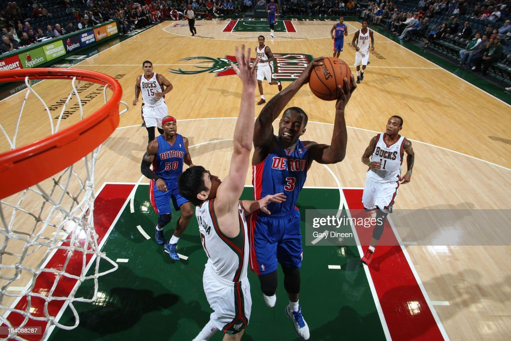 <a gi-track='captionPersonalityLinkClicked' href=/galleries/search?phrase=Rodney+Stuckey&family=editorial&specificpeople=4375687 ng-click='$event.stopPropagation()'>Rodney Stuckey</a> #3 of the Detroit Pistons shoots against <a gi-track='captionPersonalityLinkClicked' href=/galleries/search?phrase=Ersan+Ilyasova&family=editorial&specificpeople=557070 ng-click='$event.stopPropagation()'>Ersan Ilyasova</a> #7 of the Milwaukee Bucks during the NBA preseason game on October 13, 2012 at the BMO Harris Bradley Center in Milwaukee, Wisconsin.