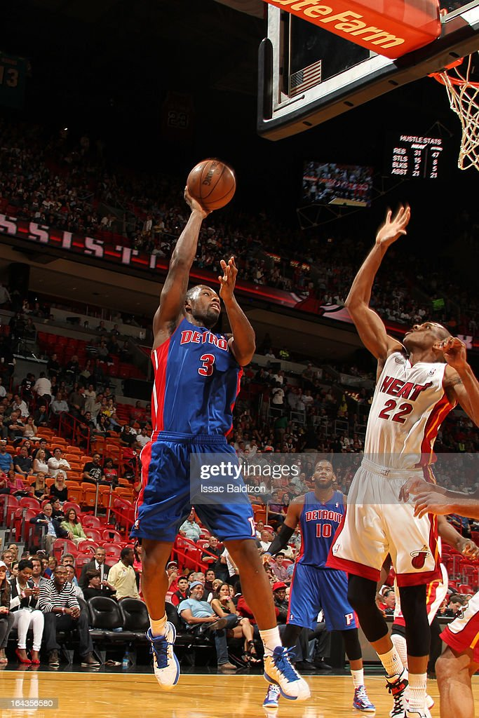Rodney Stuckey #3 of the Detroit Pistons shoots against James Jones #22 of the Miami Heat on March 22, 2013 at American Airlines Arena in Miami, Florida.
