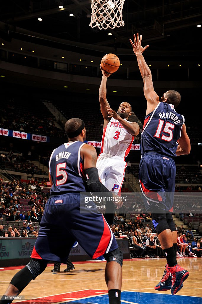 Rodney Stuckey #3 of the Detroit Pistons shoots in the lane against Al Horford #15 of the Atlanta Hawks on February 25, 2013 at The Palace of Auburn Hills in Auburn Hills, Michigan.