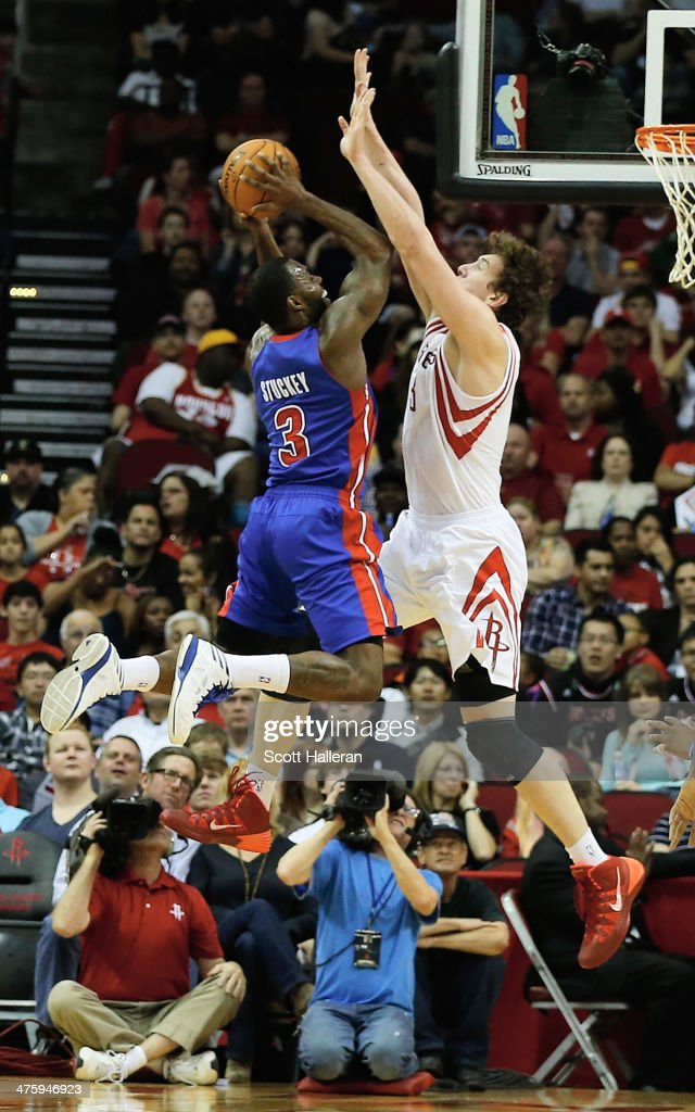 <a gi-track='captionPersonalityLinkClicked' href=/galleries/search?phrase=Rodney+Stuckey&family=editorial&specificpeople=4375687 ng-click='$event.stopPropagation()'>Rodney Stuckey</a> #3 of the Detroit Pistons shoots over <a gi-track='captionPersonalityLinkClicked' href=/galleries/search?phrase=Omer+Asik&family=editorial&specificpeople=4946055 ng-click='$event.stopPropagation()'>Omer Asik</a> #3 of the Houston Rockets during the game at the Toyota Center on March 1, 2014 in Houston, Texas.