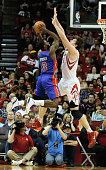 Rodney Stuckey of the Detroit Pistons shoots over Omer Asik of the Houston Rockets during the game at the Toyota Center on March 1 2014 in Houston...