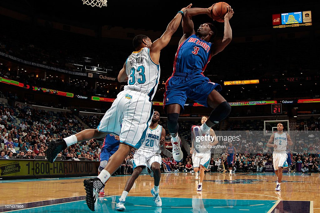 Rodney Stuckey of the Detroit Pistons shoots the ball over Willie Green of the New Orleans Hornets at the New Orleans Arena on December 8 2010 in New...