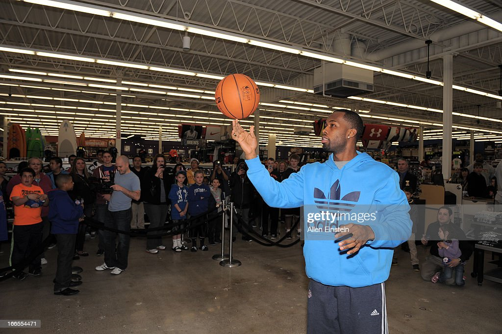 Rodney Stuckey, of the Detroit Pistons, takes a trick shot during a game of 'PIG' begins on April 13, 2013 at Dunhams sporting goods in Warren, Michigan.