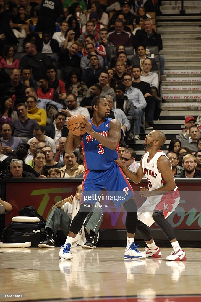 Rodney Stuckey #3 of the Detroit Pistons trys to pass the ball against John Lucas #5 Toronto Raptors of during the game on December 19, 2012 at the Air Canada Centre in Toronto, Ontario, Canada.