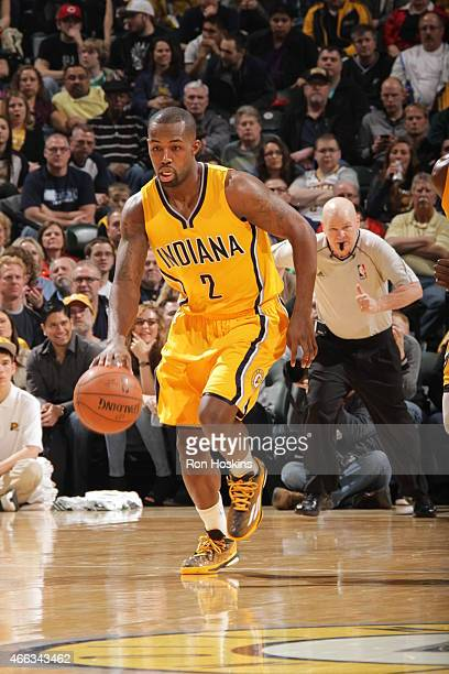 Rodney Stuckey of the Indiana Pacers brings the ball up court against the Boston Celtics on March 14 2015 at Bankers Life Fieldhouse in Indianapolis...