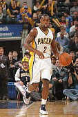 Rodney Stuckey of the Indiana Pacers dribbles the ball against the Philadelphia 76ers at Bankers Life Fieldhouse on October 29 2014 in Indianapolis...