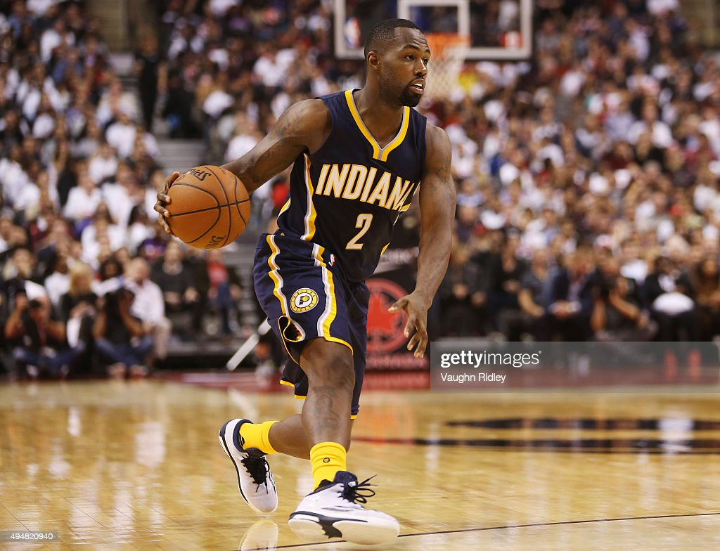 Rodney Stuckey of the Indiana Pacers dribbles the ball during the NBA season opener against the Toronto Raptors at Air Canada Centre on October 28...